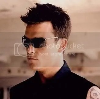Photo of Robbie Williams spiky hairstyle.