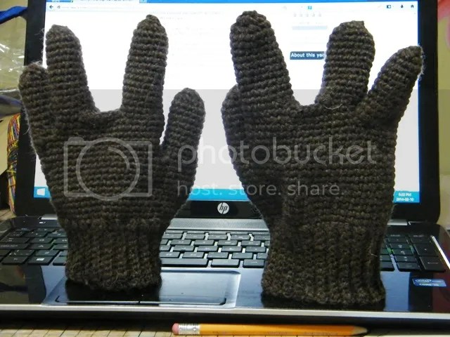brown gloves, missing the middle fingers