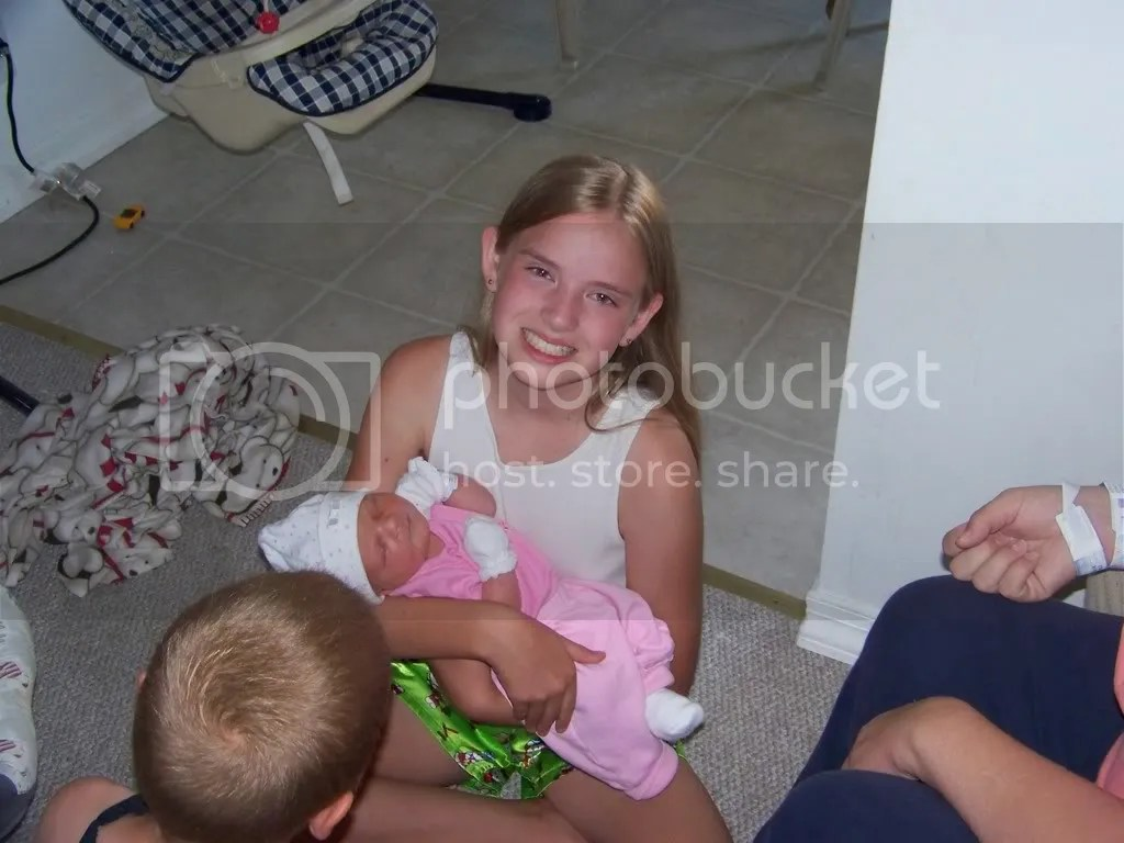 Allie holds Kaitlyn for the first time