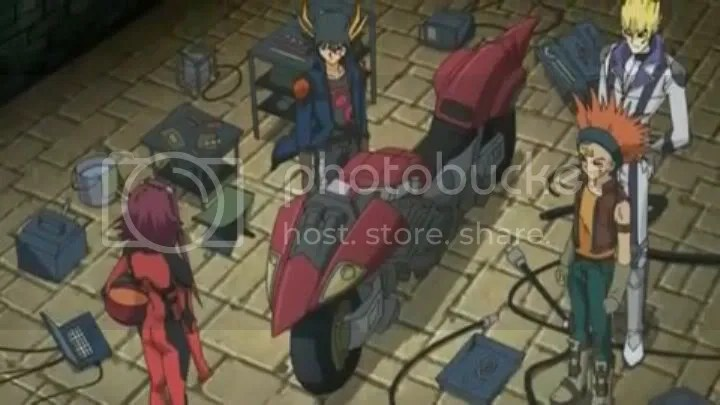 Akis D-Wheel. Yusei is proud to inform Aki that he made it through junk he found from god-knows-where.