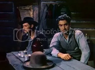 Would you turn your back on this man? John Carradine & Tyrone Power