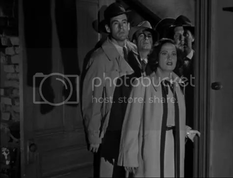 Robert Ryan & Merle Oberon arriving just too late.