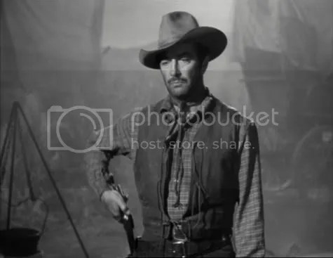 Robert Taylor, after handing out his own brand of frontier justice, in Westward the Women.