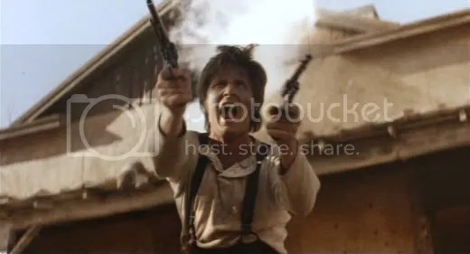 All guns blazing - Emilio Estevez as the Kid.