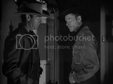 Randolph Scott & Errol Flynn going toe to toe in Virginia City