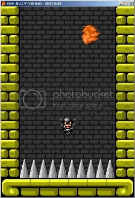 A room made of gold bricks. Gray spikes stick out of the floor; a flaming head floats high above. Between them, a pixelated woman clad in leather floats in mid-air.