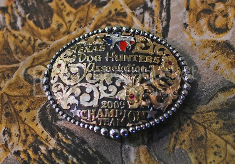 The winning team receieved over $3,000 in cash and prizes, including these Texas Dog Hunters Association buckles.