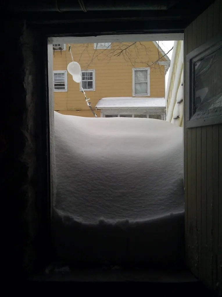 Snow in front of door