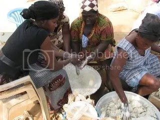 Aunties making Ga Kenke Balls in corn husks