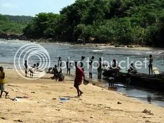 Kids playing near fishing boat