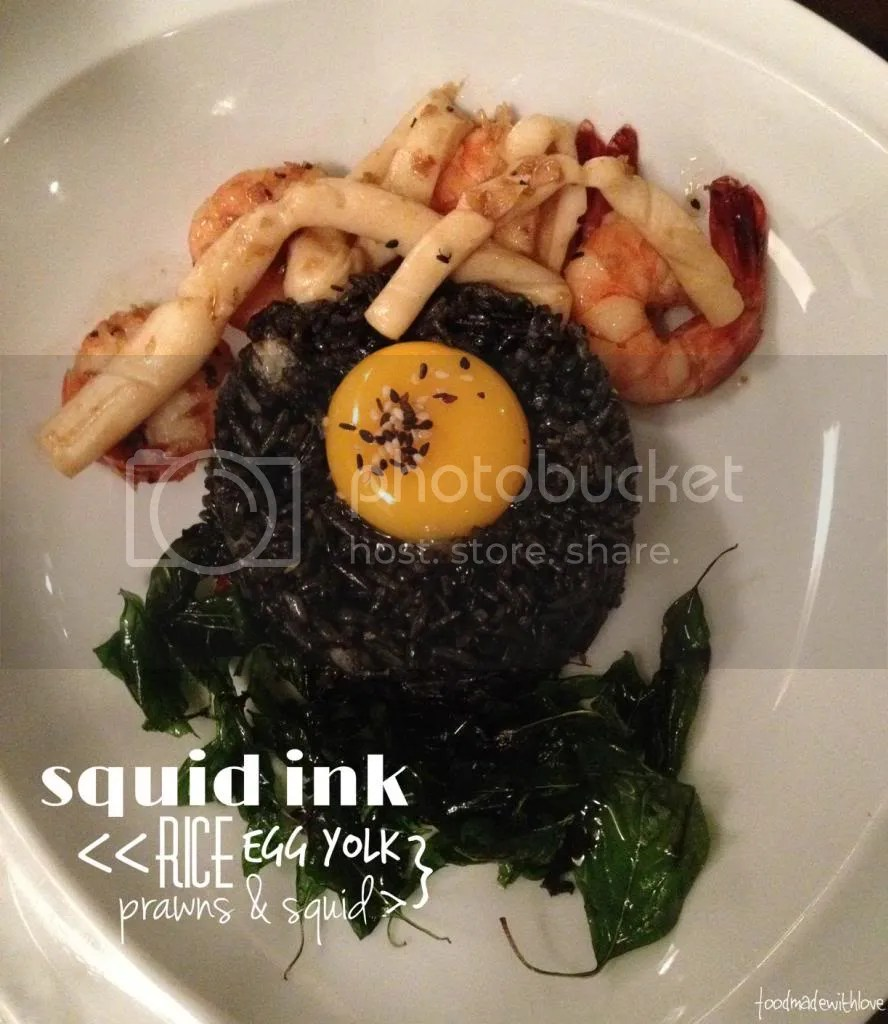 Squid ink rice with prawns and squid