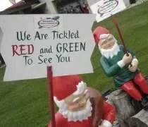 A couple elves welcoming you to Bronners CHRISTmas Wonderland.