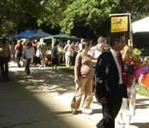 Shoppers looking for deals at the farmers market at the State Capitol