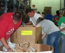 Volunteers stock the shelves at the Mid-Michigan Food Bank.