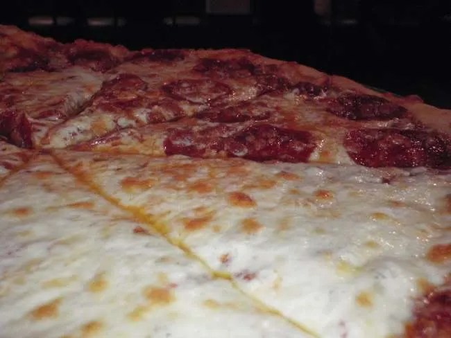 A large half cheese, half pepperoni pizza.