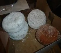 A half dozen...minus two...paczkis from Quality Dairy