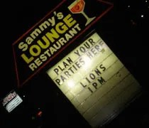 The sign for Sammys Lounge I always drive by on Jolly Rd.