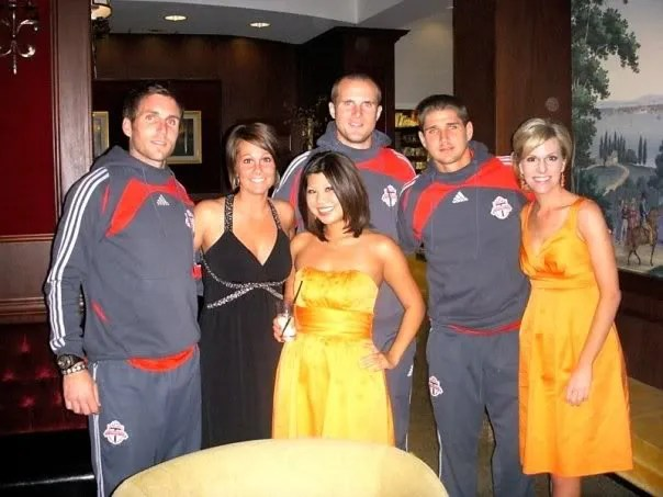 A couple bridesmaids and one of my groomsmans wife posing with soccer players from Toronto FC