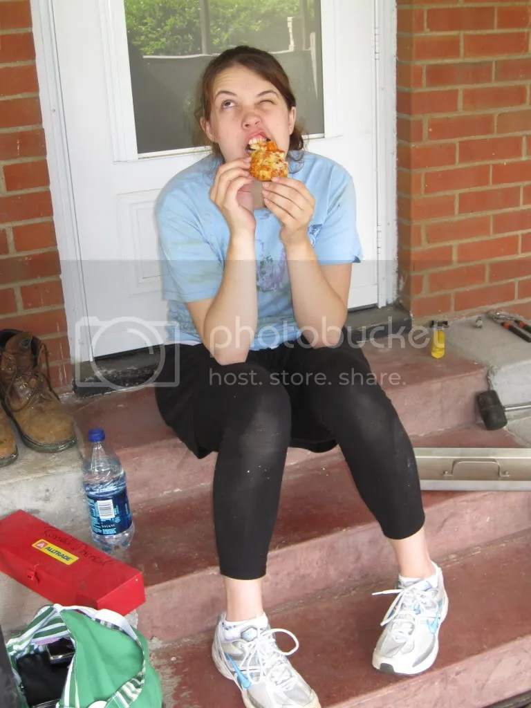 Taking a break to eat the delicious pizza. Yumm!
