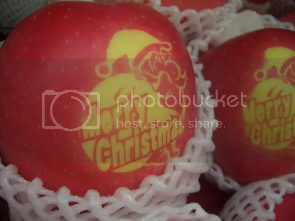 close-up on the apple. Merry Christmas is written on it!