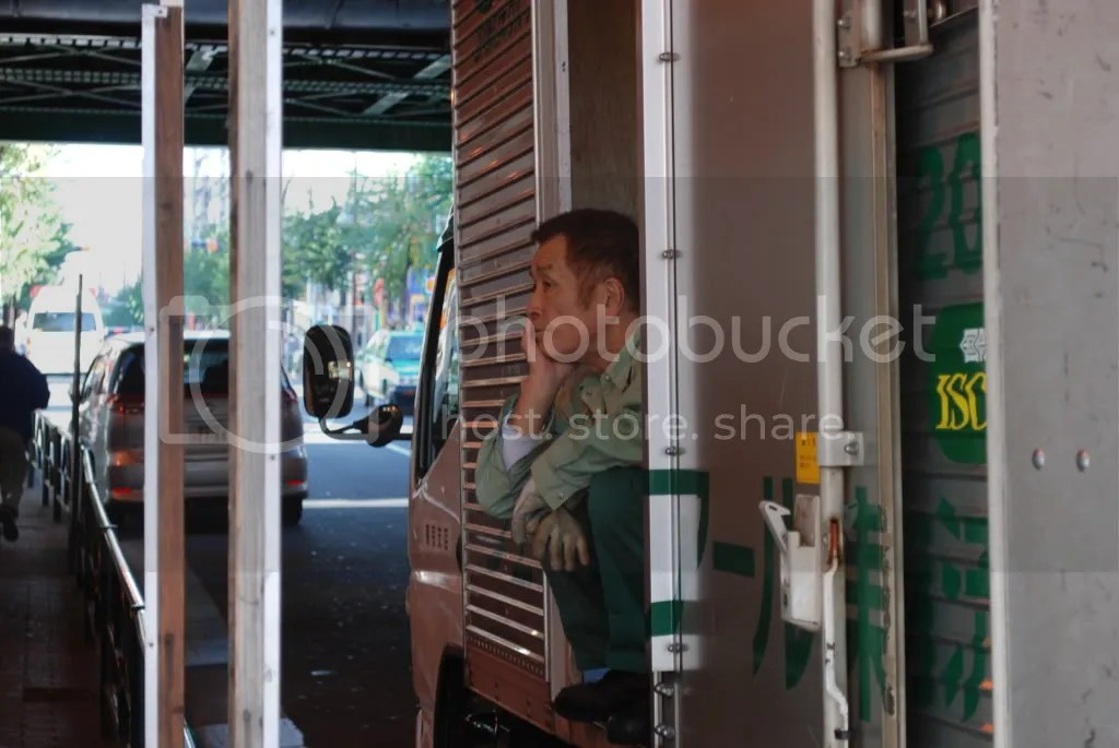A worker takes a break in his truck.
