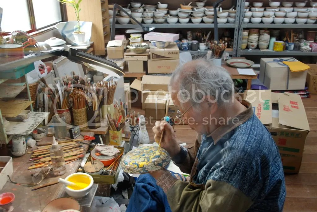 Painting traditional pottery in a style called Kiyomizu-yaki (清水焼), as in the Kiyomiziu temple, because they make this style of pottery at the base of the hill the Kiyomiziu temple is on