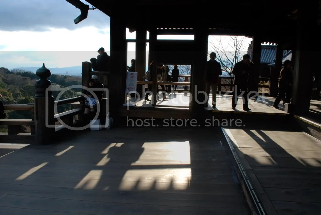 Sunlight hitting the inside of the famous part of the temple that juts out over the hill and looks out over the city