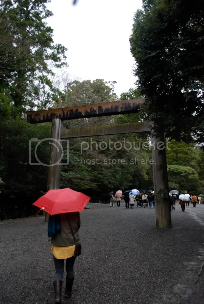 My friend, with her lovely red umbrella, walking up to the shrine