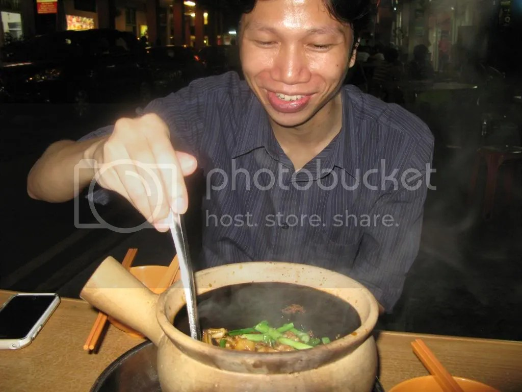 My host, Foo, digging into a claypot filled with frogs. Yum! *ribbit