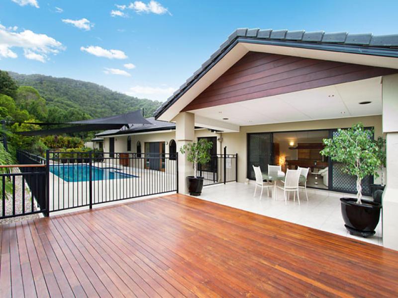 Indoor-outdoor outdoor living design with pool ... on Fancy Outdoor Living id=80351