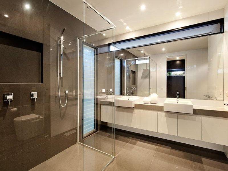 Modern bathroom design with twin basins using glass ... on Main Bathroom Ideas  id=18554