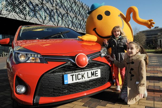 Sisters Lowri and Erin Beresford with the Ticklish Toyota in Birmingham's Centenary Square to raise money for Comic Relief.