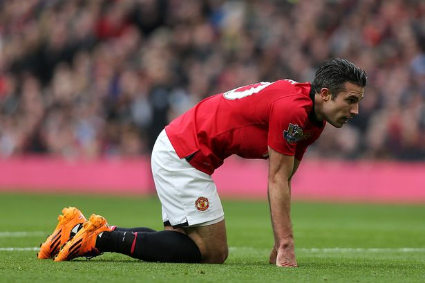 Manchester United's Robin van Persie picks himself up off the ground during the Barclays Premier League match at Old Trafford