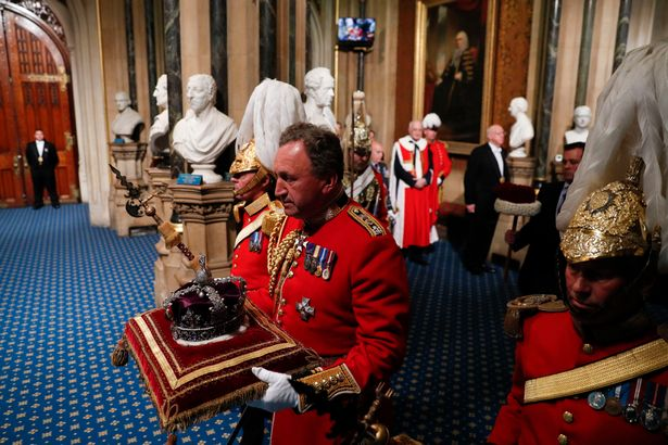 Lieutenant Colonel Andrew Ford carries the Imperial State Crown into the Palace of Westminster