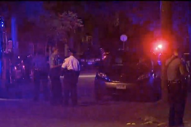 Police officers at the scene after Ms Damond was shot dead (Image: kare11)