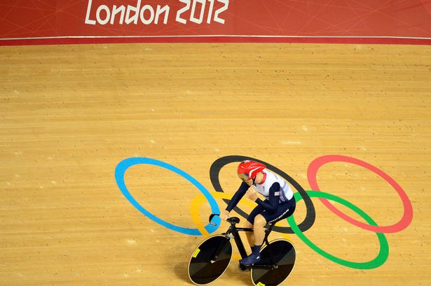 Great Britain's Chris Hoy celebrates after winning the Men's team sprint gold final