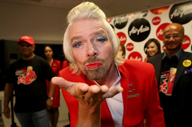 Richard Branson blows a kiss before boarding his flight