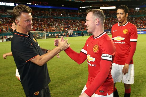 Louis van Gaal congratulates Wayne Rooney after the pre-season friendly match between Manchester United and Liverpool