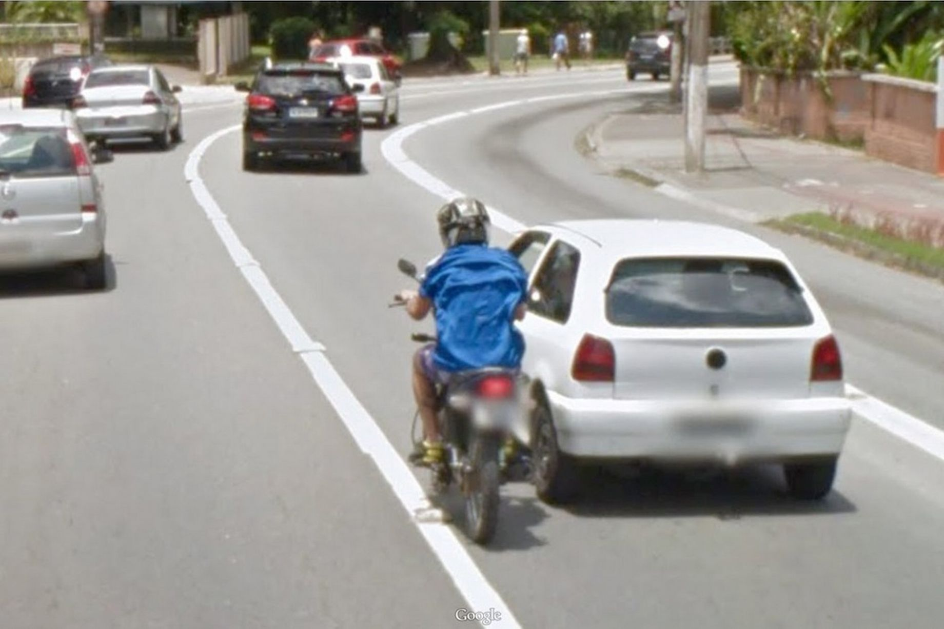 This motorcyclist had a lucky escape after crashing into a car with the whole episode captured on Google Street View.