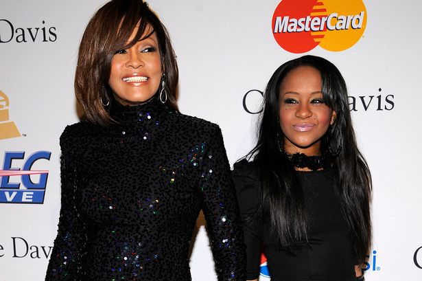 Singer Whitney Houston attends the Pre-Grammy Gala & Salute to Industry Icons with Clive Davis with her daughter Bobbi Kristina Brown on Febraury 11, 2012