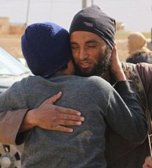 A hug from the executioner... then two gay men are stoned to death: ISIS murderers stage show of kindness for the cameras before brutal killing