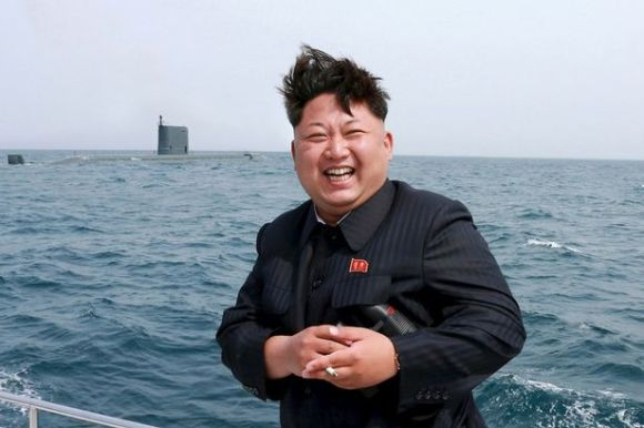 Bloodthirsty: Dictator Kim Jong Un watches the test fire of a strategic submarine underwater ballistic missile