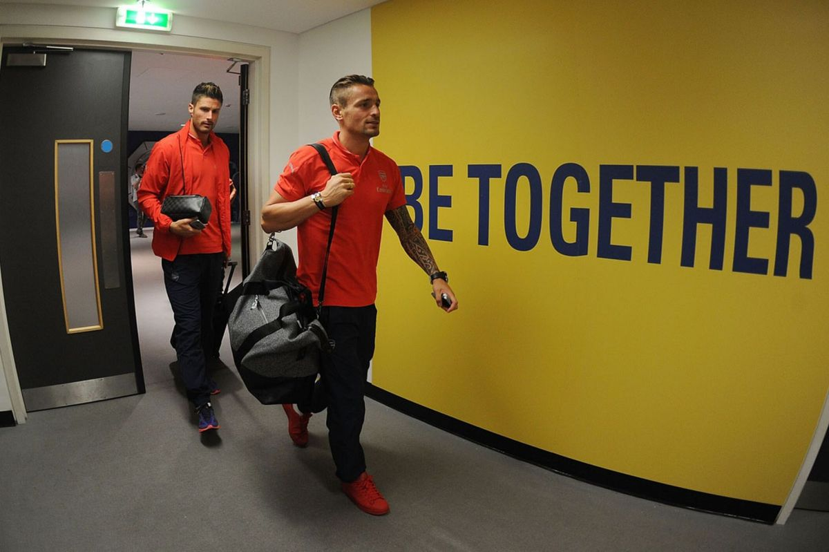 Olivier Giroud and Mathieu Debuchy enter the Arsenal changing room