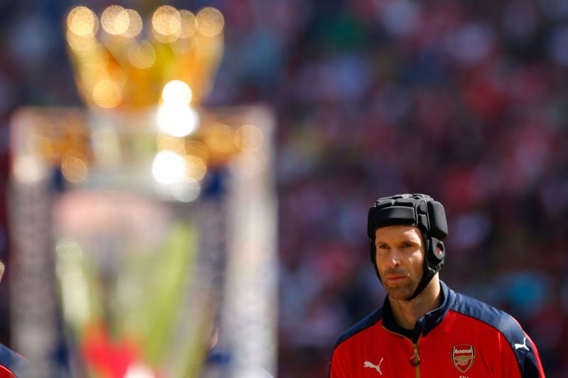 Petr Cech behind the Barclays Premier League trophy before the match