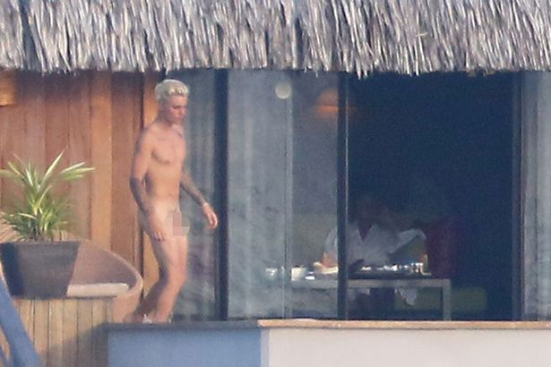 Justin Bieber goes swimming naked in his water villas pool in front of rumoured new girlfriend model Jayde Pierce and then plays the guitar for her at sunset.