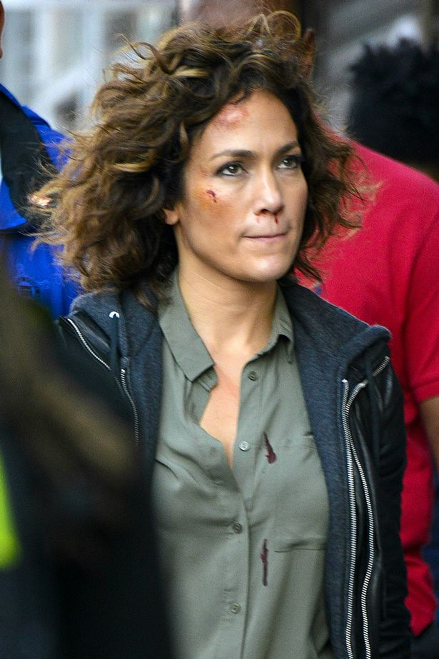 Jennifer Lopez looks battered and bruised on the set of 'Shades of Blue' in New York City.