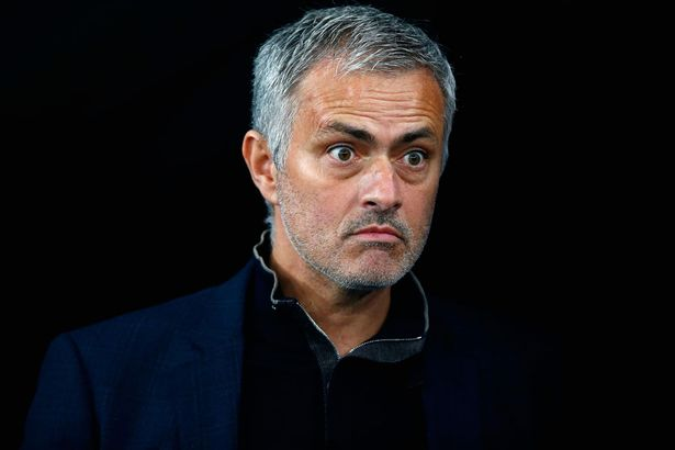 Jose Mourinho looks on