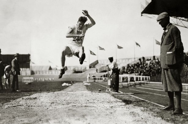 1924 Olympic Games in Paris. Pentathlon. Robert Legendre, USA. competing in the Long Jump discipline in the Pentahlon