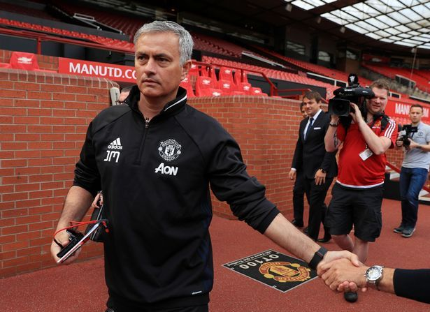 Jose Mourinho arrives for a photocall at Old Trafford