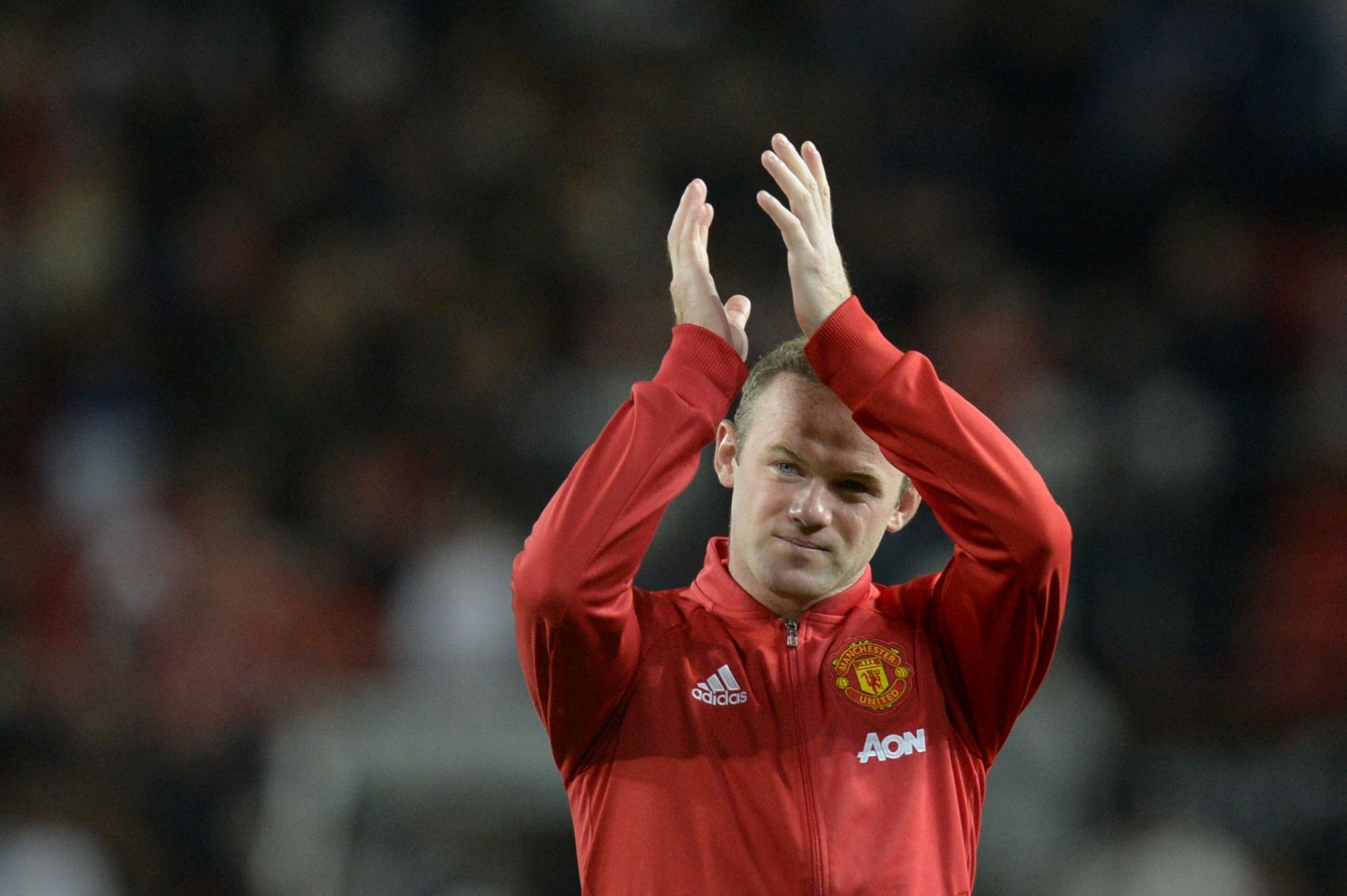 Wayne Rooney applauds the fans at the end of the testimonial